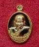 เหรียญเม็ดแตงรุ่นแรก พ่อท่านพรหม วัดพลานุภาพ ปัตตานี ปี2554 เนื้อกะไหล่ทอง โค๊ต ก หมายเลข 56