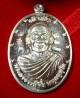 เหรียญเจ้าสัวบน 59 เนื้อเงินพิเศษ ๙ รอบ หลวงปู่จื่อ พนฺธมุตฺโต วัดเขาตาเงาะอุดมพร จ.ชัยภูมิ เลข ๓